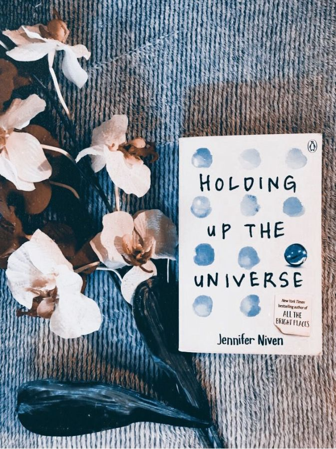 "If you're a fan of romantic books, I recommend you reading this one 💙 ""Holding up the universe"" #books #bookstagram #booklovers #reading"